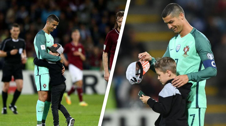 83ab9486759aa Malý fanúšik z Lotyšska vtrhol na ihrisko počas zápasu s Portugalskom a  objal Cristiana Ronalda! MS vo Futbale ...